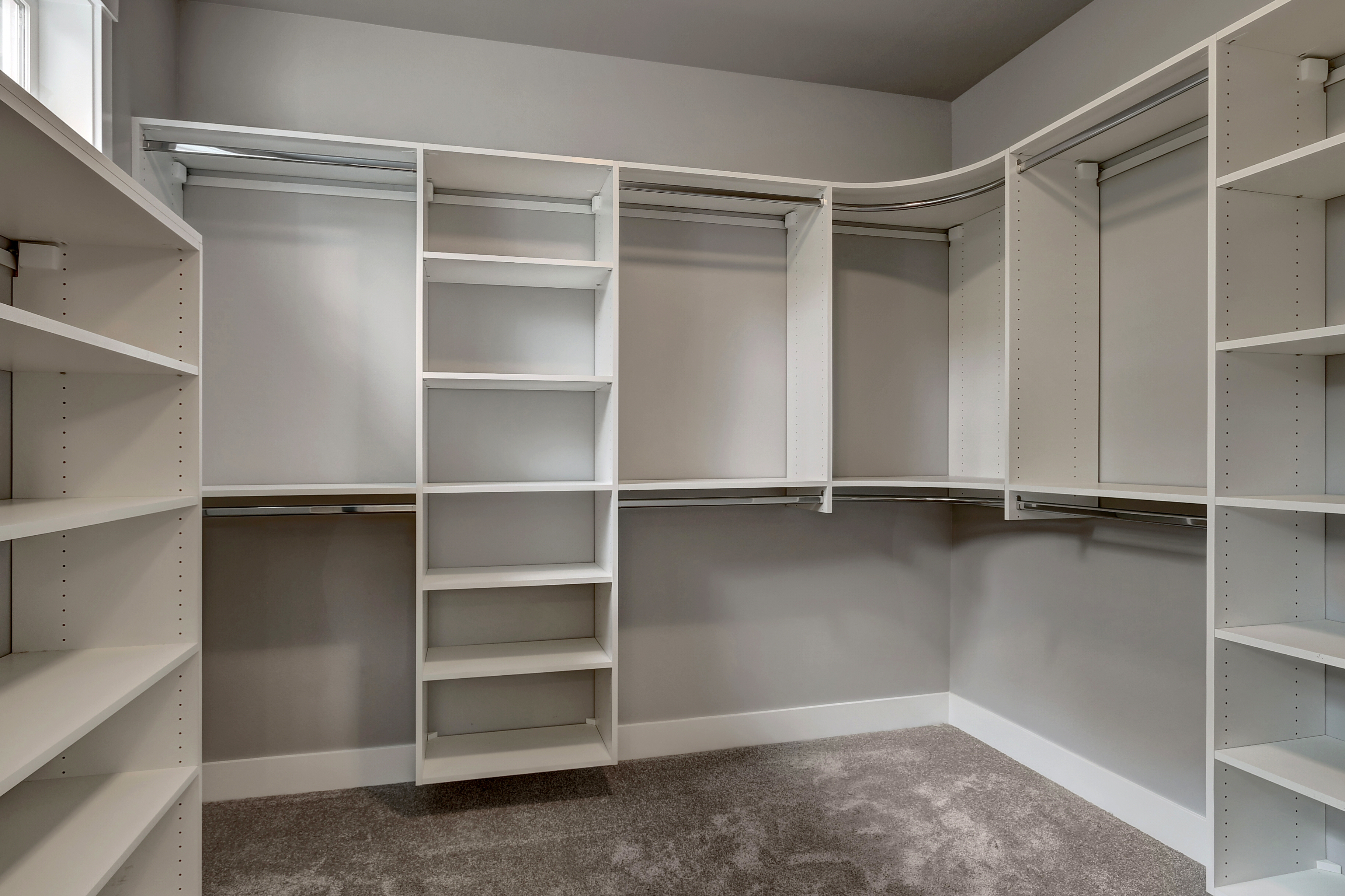 Master closet with melamine built-in shelving system closet organizer