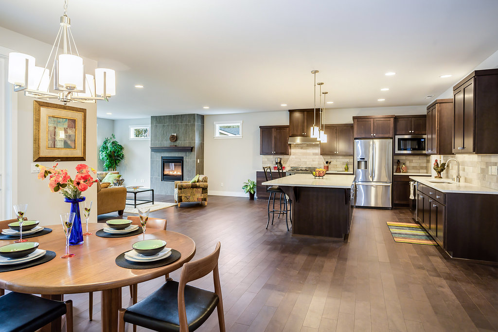 Open floorplan looking from dining into kitchen